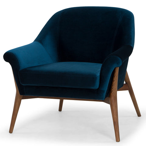 The Charlize Occasional Chair in midnight blue velvet with ash stained walnut legs