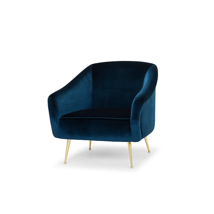 The Lucie Occasional Chair in midnight blue velvet with satin brass legs