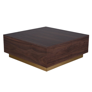 The Jonas coffee table in walnut veneers and matte gold base