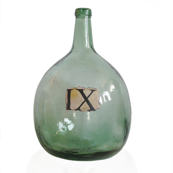 Large antique glass wine jar in green