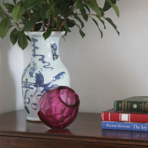 Faceted Geometric Glass Vase in Magenta on table