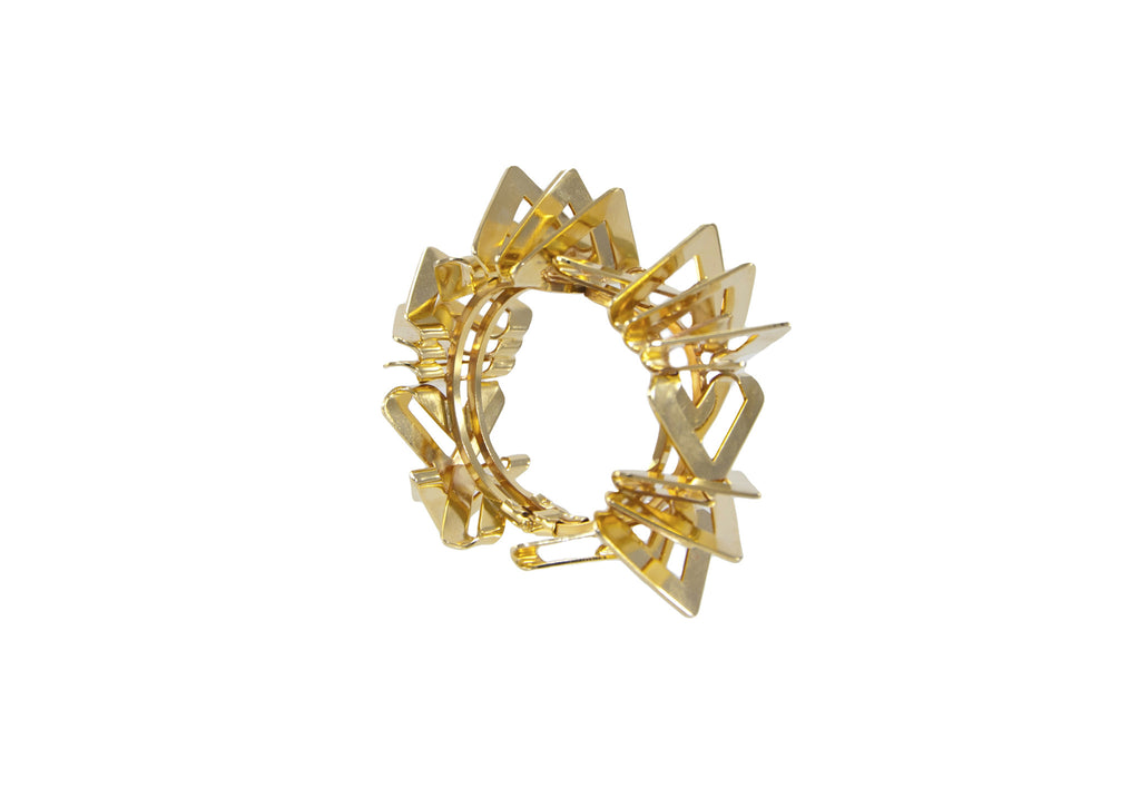 14 kt plated gold statement bracelet.