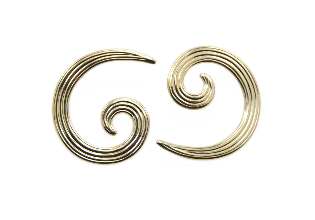 gold swirl earrings.