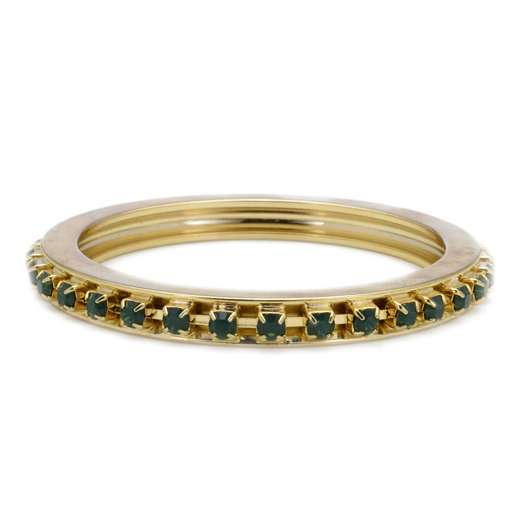14 kt gold plated bangle with emerald green swarovski crystal detail on inside