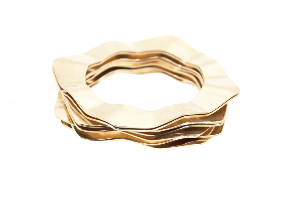 Wave bangles in 14 kt plated gold