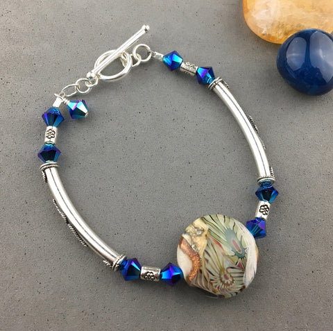 FOSSIL II ~ STERLING SILVER WRAP WITH HANDMADE GLASS BEAD
