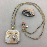 BUCK ~ HAND PAINTED MINIATURE ART PENDANT WITH ANTIQUE BRASS CHAIN