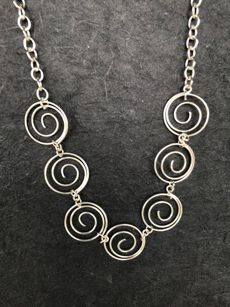 Seven Silver Spirals Necklace