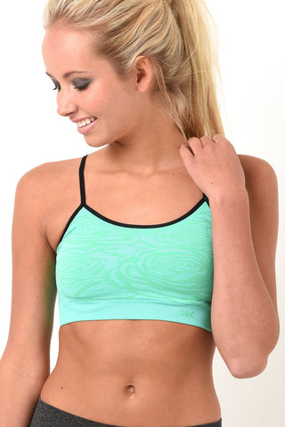 Mint green and black sports bra