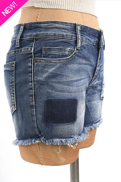 Distressed patch denim shorts