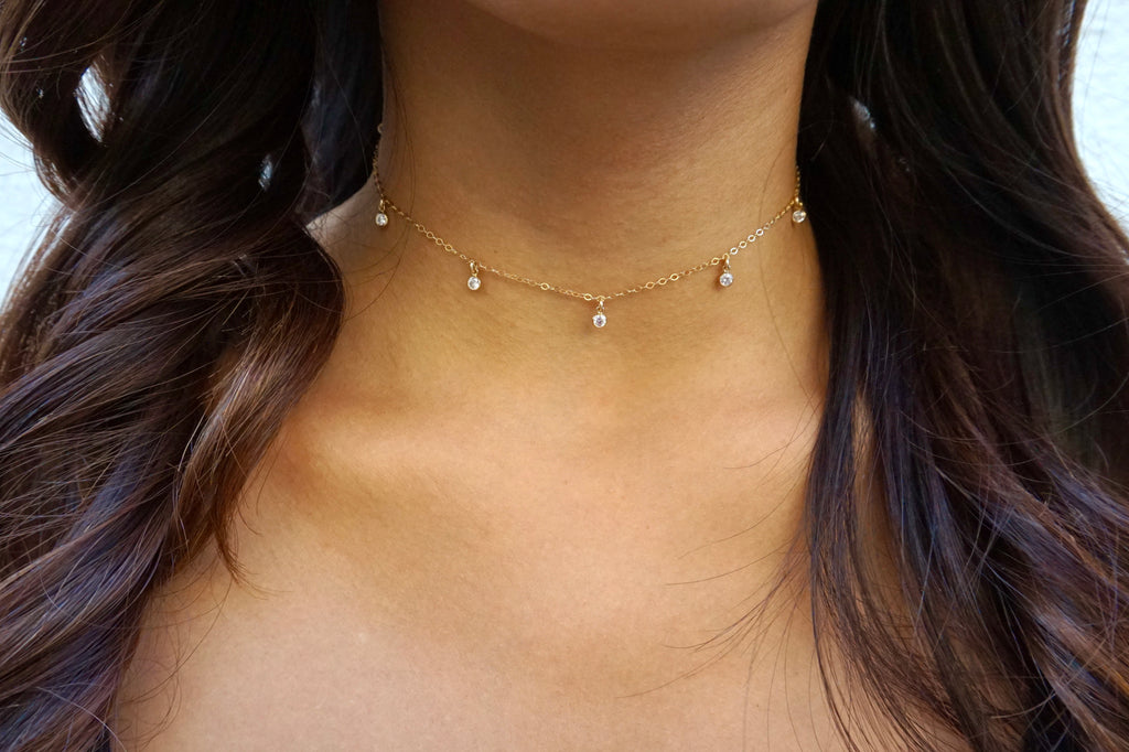 Seven-gem choker modeled on a woman with long hair