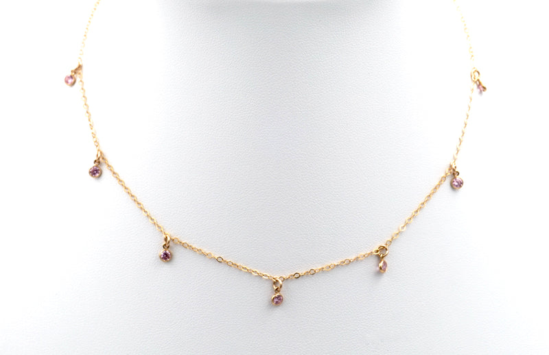 The 7-stone pink choker necklace.  Pink gemstones dangling from a dainty gold chain.