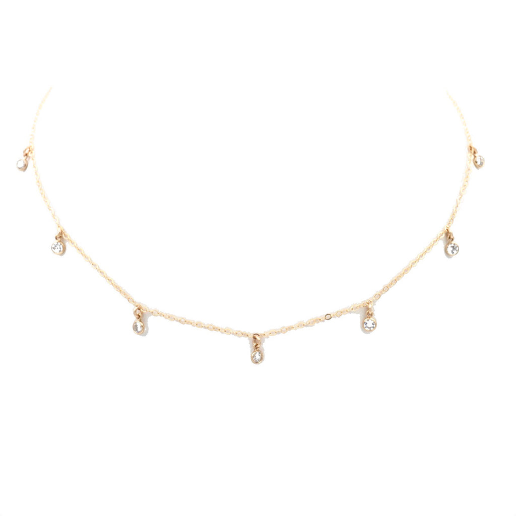 7-Gem choker, with a gold chain and seven clear gemstones.