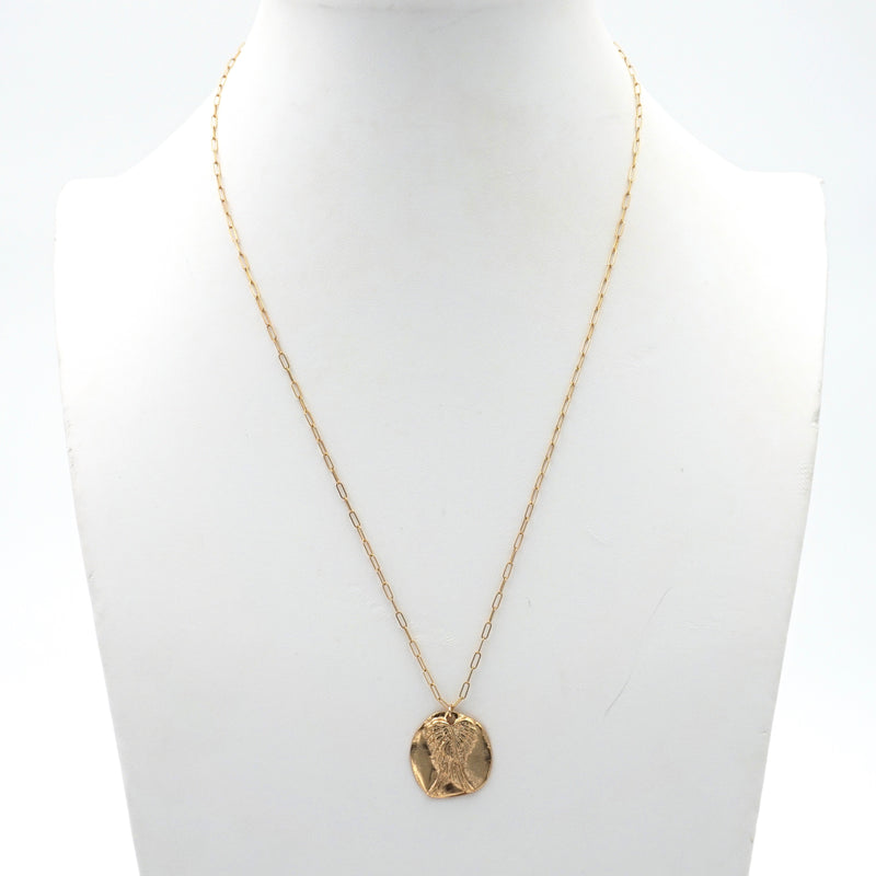 A sleek, modern gold chain with a coin pendant on it that has a design of angel wings seen from the back.