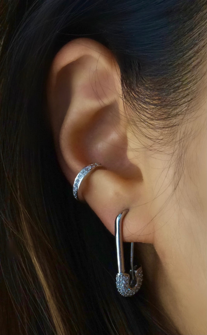 Silver safety pin earring on a model.