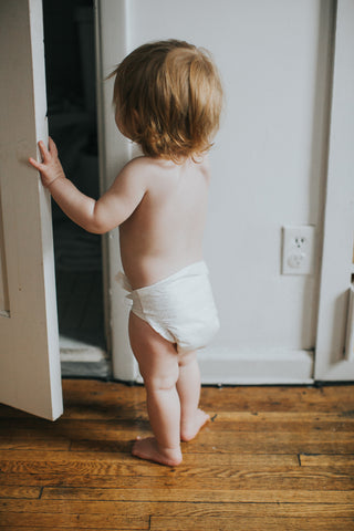Baby exploring in eco-friendly baby diapers