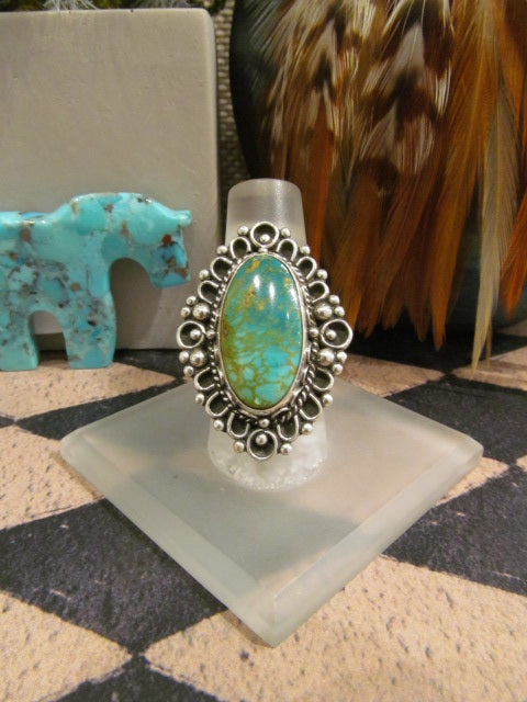 TURQUOISE RING WITH SILVER EDGING