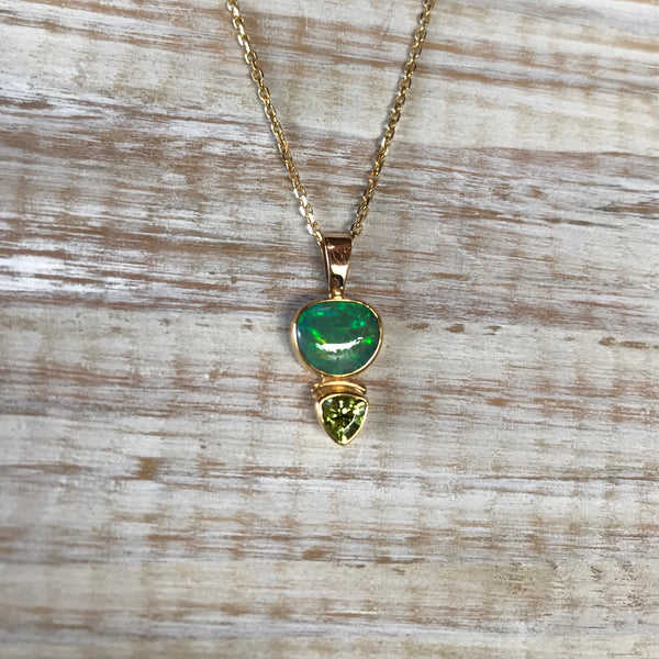 ETHIOPIAN OPAL OVAL AND PERIDOT TRILLION 14K PENDANT