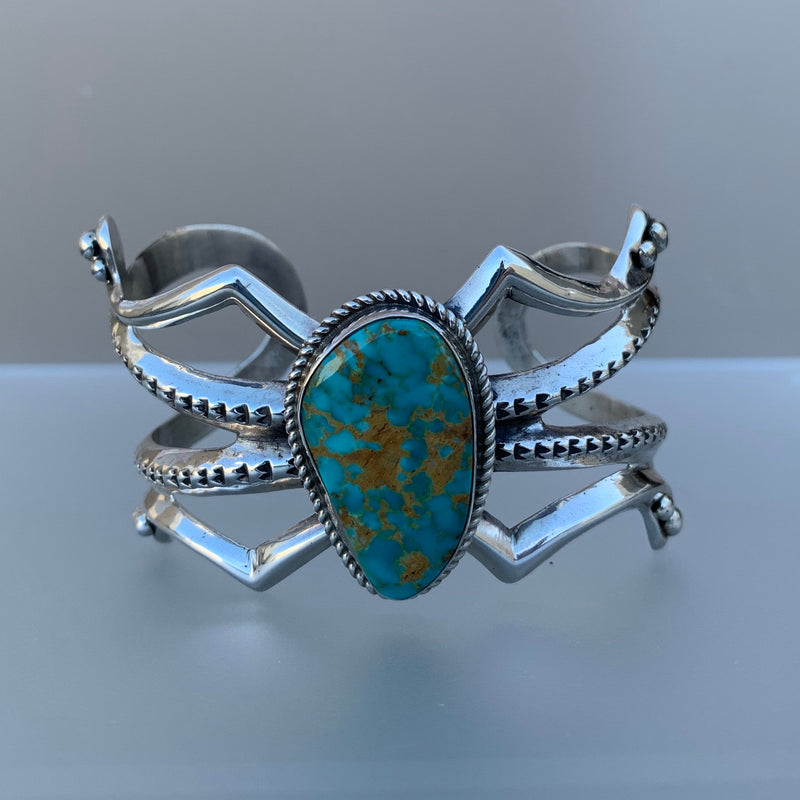 SANDCAST CUFF WITH TURQUOISE STONE