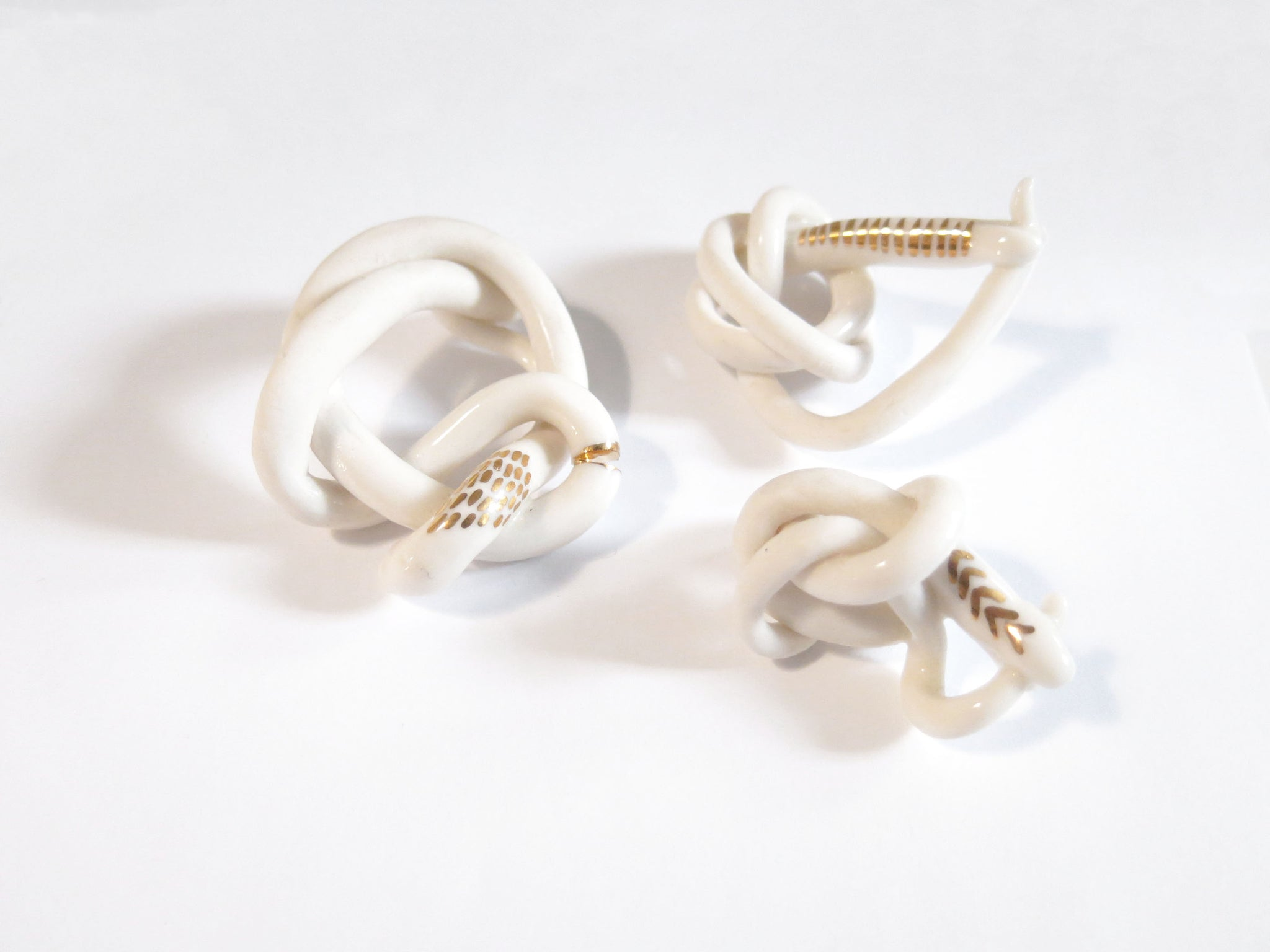 THREE PORCELAIN SNAKES