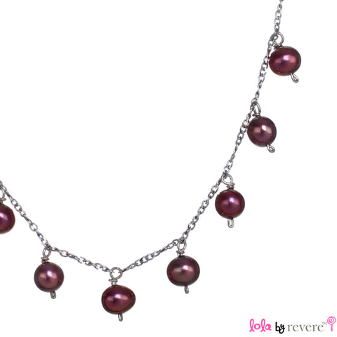 Metallic red freshwater pearls delicately scattered on a sterling silver chain with rhodium plating. Ideal pearls for a 13th or 16th birthday present.