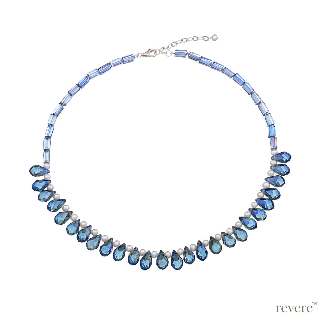 Sparkling blue crystal weaved together with freshwater white pearls as a beautiful statement necklace with sterling silver adjustable chain. Sure to be the fun accessory in any gathering!