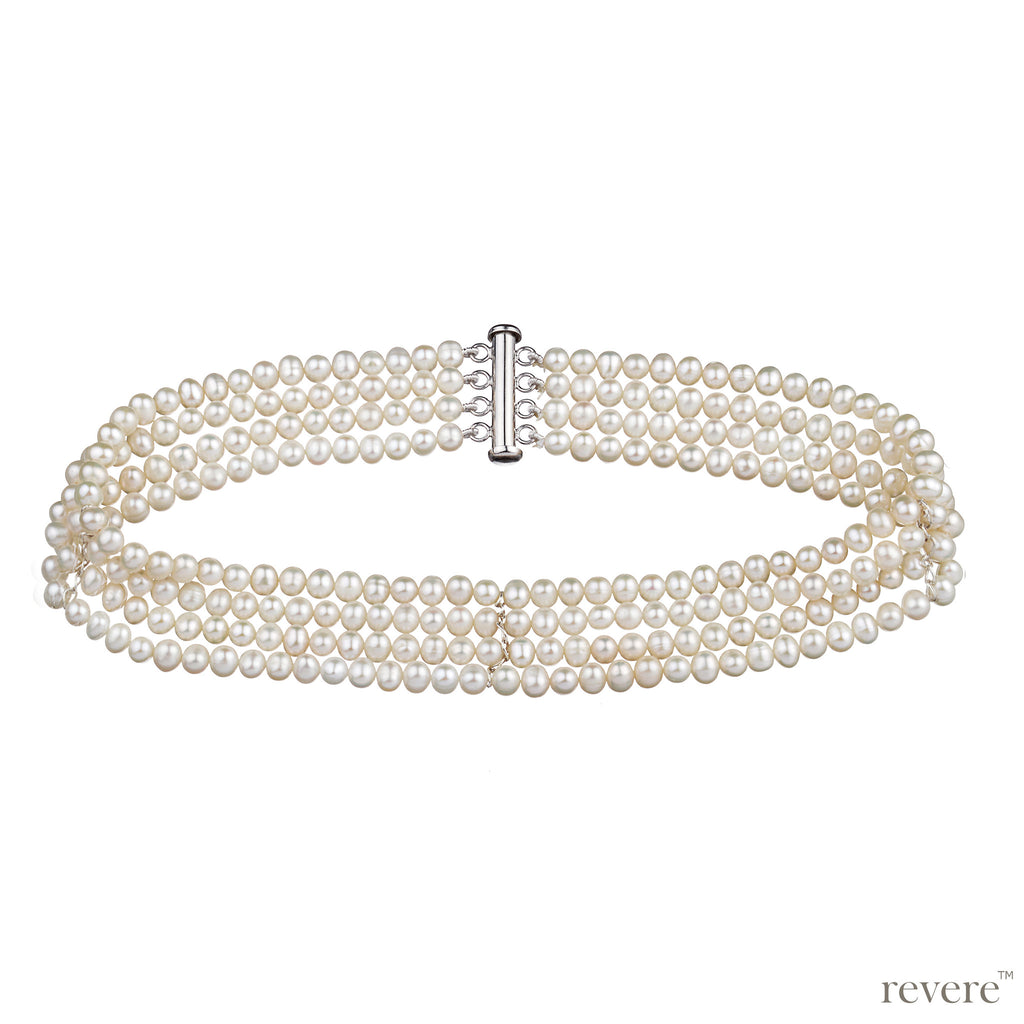 Regalia features multiple strands of hand selected white freshwater pearls. The pearl choker is a timeless classic.