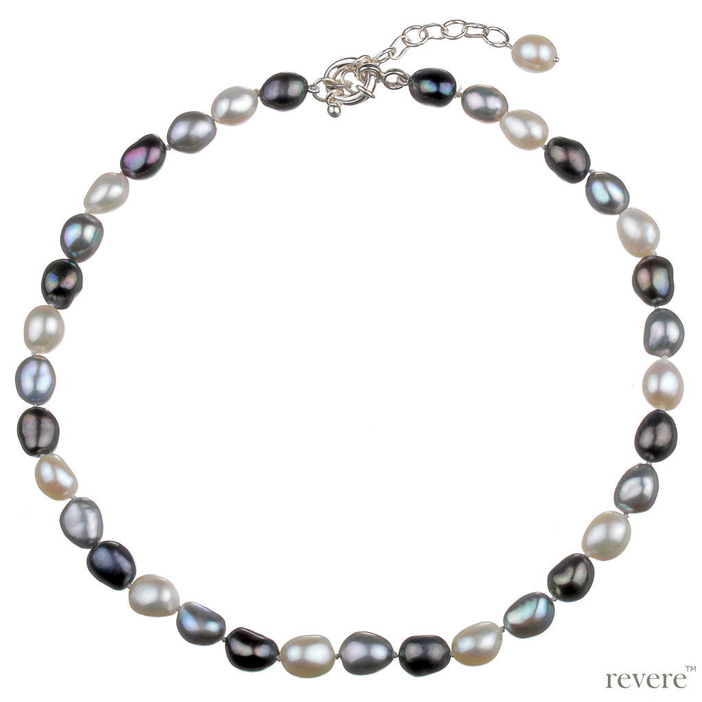 An eye catching piece hand crafted out of high lustre baroque pearls in metallic grey contrasted with warm whites, fastened by a sterling silver clasp with a 2 inch adjustable chain.
