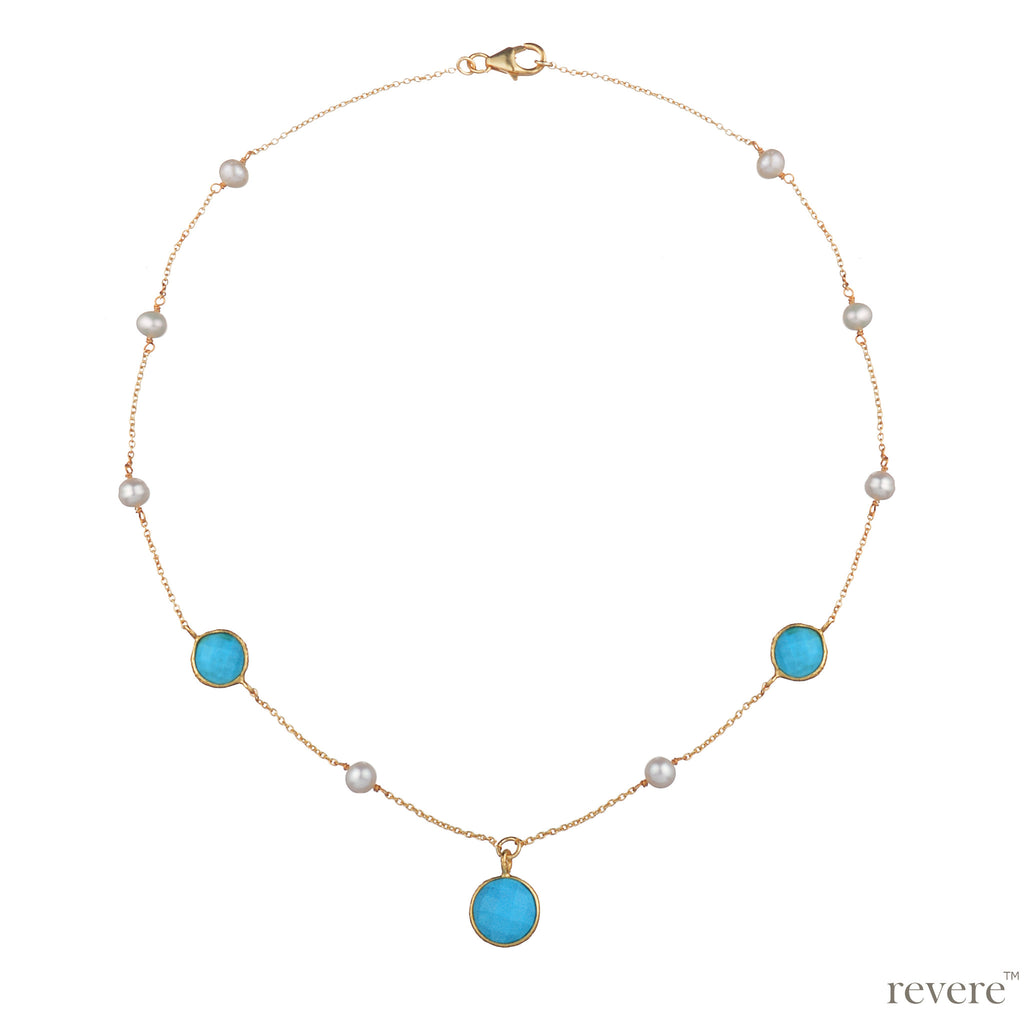 This pretty necklace is contrasted with reconstructed turquoise beads and white freshwater pearls wrapped onto gold plated sterling silver chain. Sure to enhance any outfit anytime of the day!