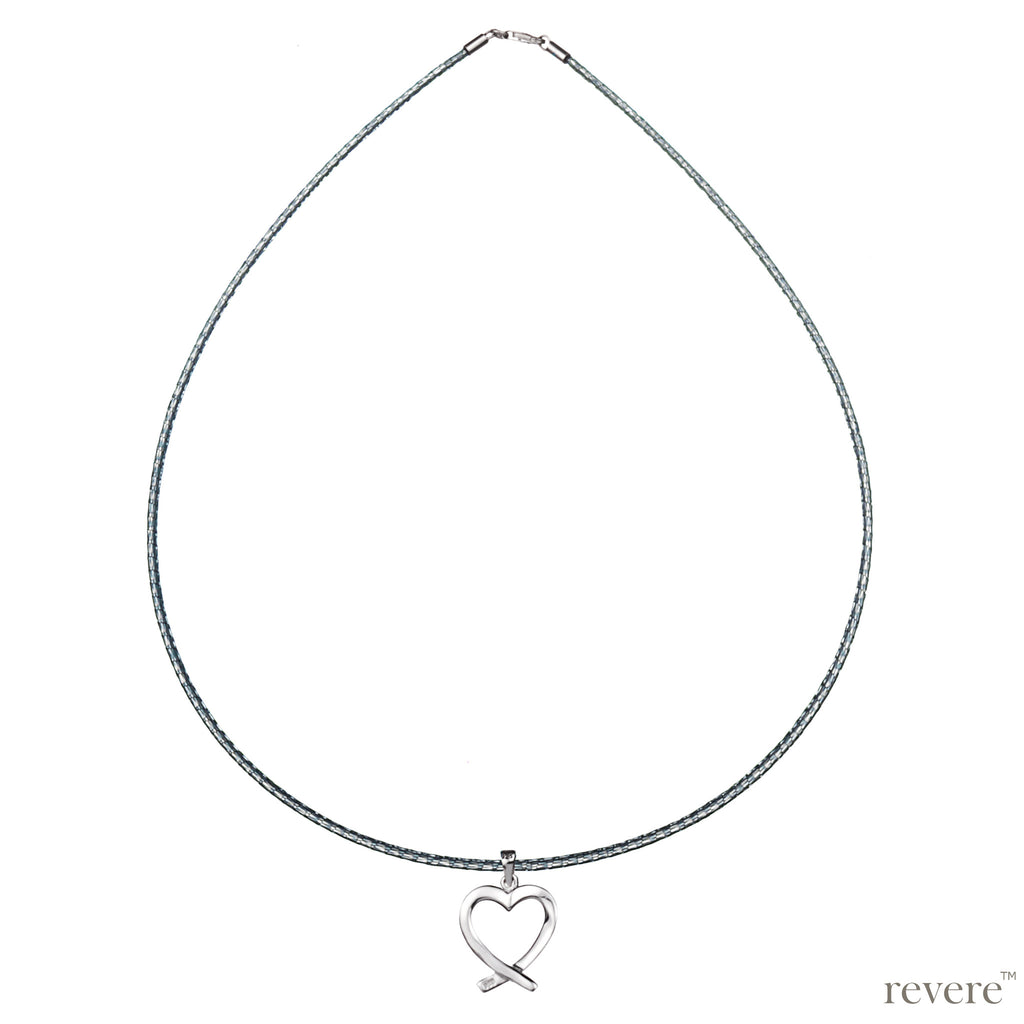 Necklace features a sweet indulgence with a sterling silver heart pendant suspended on a cord..depicted by the timeless symbol of love.