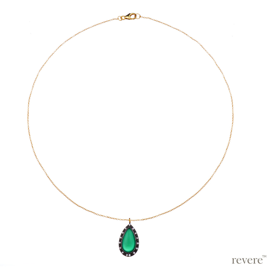 Vivid necklace is a beautiful green onyx pendant embellished with CZ stones delicately suspended on a gold plated sterling silver chain.
