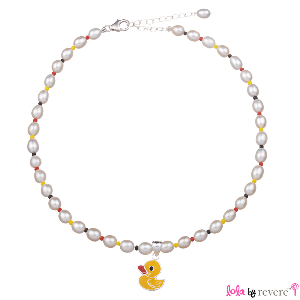 White freshwater pearls and colorful glass crystals hand-knotted with a yellow duck pendant delicately suspended.