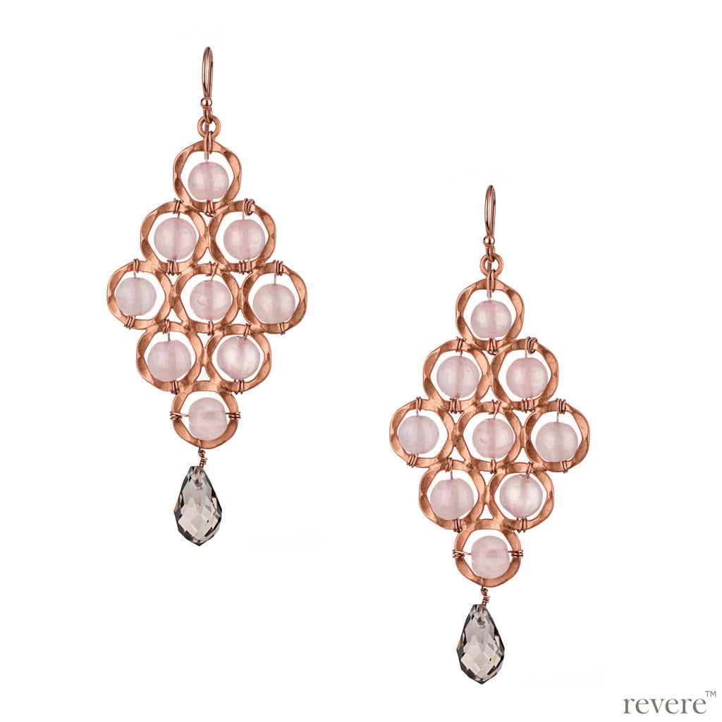 Featuring classy shine and flawless finish, this elegant geometric design earring in stunning rose gold tone with pink rose quartz and glass crystal adornment makes a perfect indulgence!