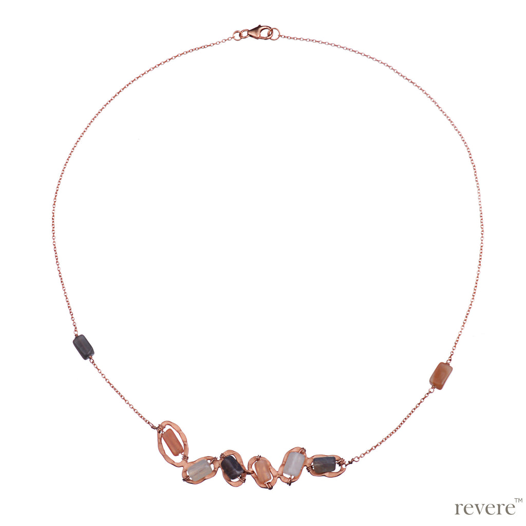Necklace features rose gold plated sterling silver chain embellished with multi-hued moonstones. Perfect for any occasion.