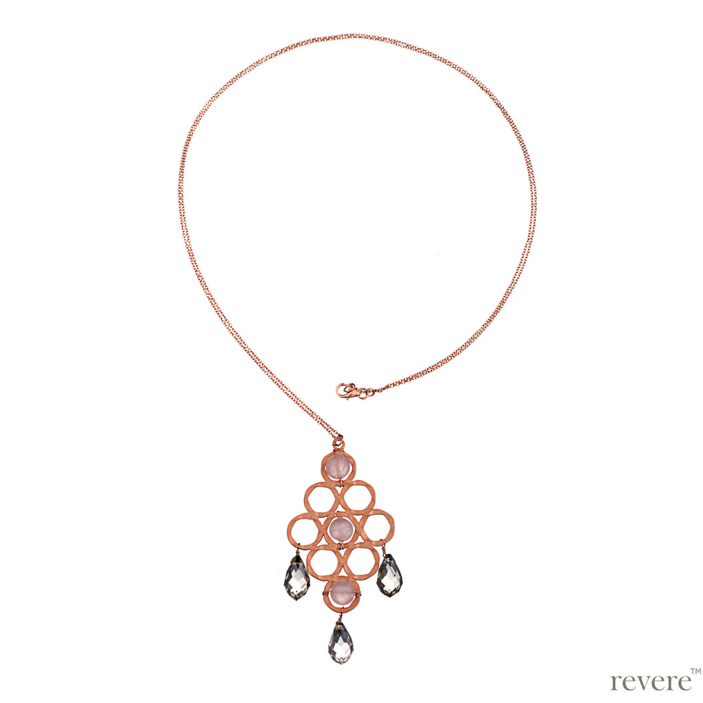 This rose gold plated sterling silver necklace features alluring design embellished with pink rose quartz and glass crystal beautifully suspended.
