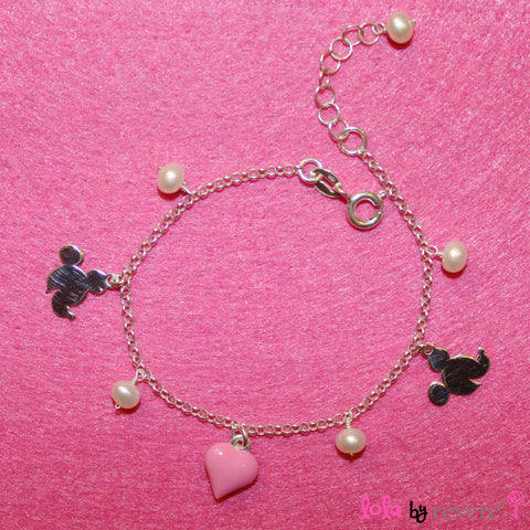 "A sterling silver charm bracelet with white pearls, minnie mouse and a pink heart. Some girls get to have all the fun!Measures 6"" with an adjustable chain of 1"" to increase length to 7""."