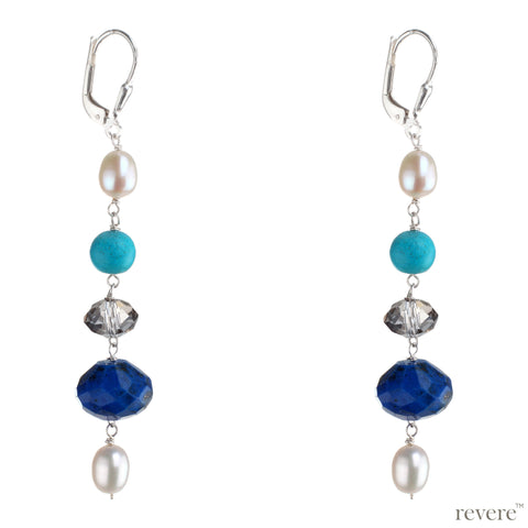 Mediterranean earrings feature a delicate design in sterling silver stringing together freshwater pearls with turquoise howlite, glass crystal and gemstone lapis lazuli. An elegant accessory for anytime wear.