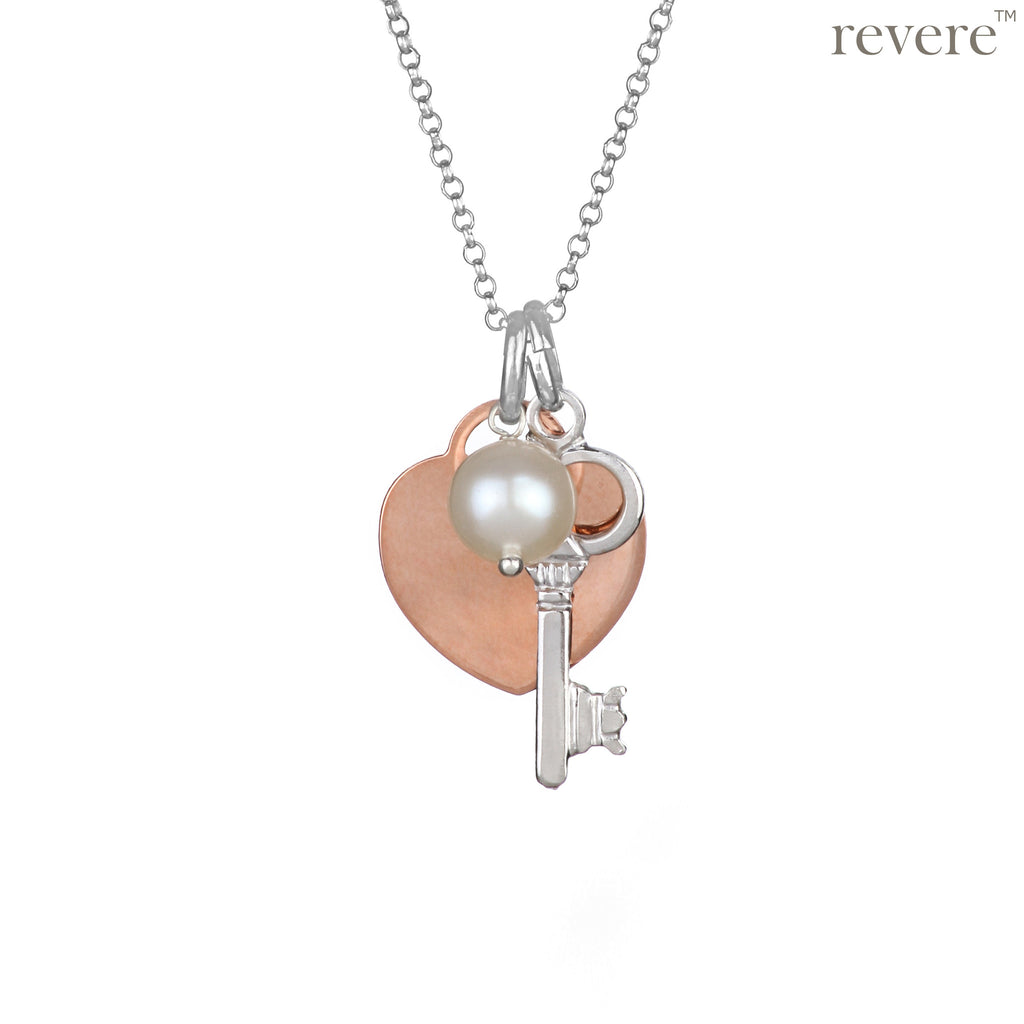 Sterling silver key charm with rose gold plated heart pendant and pearl on a sterling silver chain.