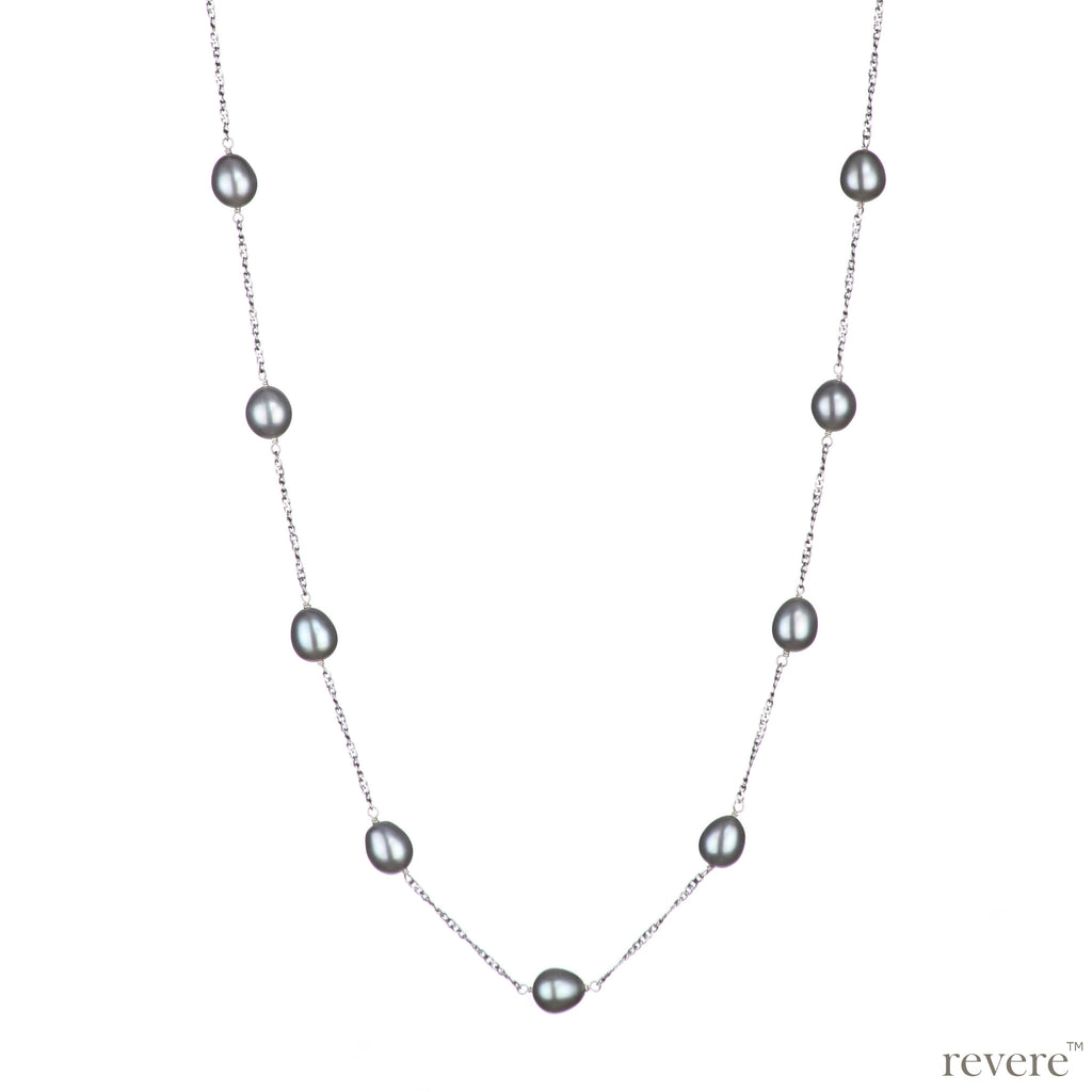 "Exquisite grey freshwater pearls scattered on a sterling silver chainwith rhodium plating. ""Naomi"" adds spice up any outfit including boardroom chic!"