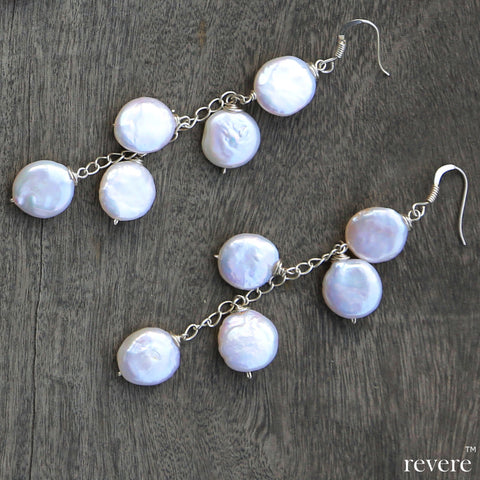 sail earrings in white AAA grade cultured fresh water coin shaped pearl set in sterling silver. Suitable for office wear and for evening dressing