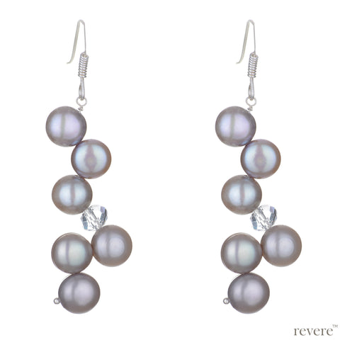 """De Luxe"" features earrings that are geometric in design, grey button freshwater pearls exquisitely threaded with clear crystal by hand and set in sterling silver. Goes well with our Luxe pearl necklace."