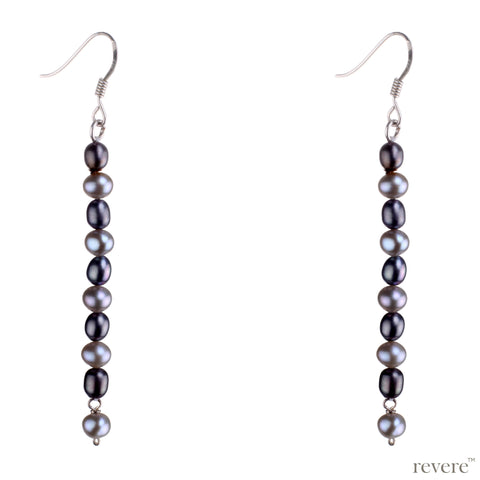 """Moody Grey"" earrings are elegant silver grey fresh water pearls on sterling silver. The alternating light and dark tones is sure to lift your mood in any setting."