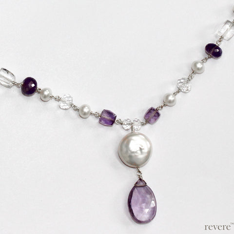 Lily of the Valley inspired by the flower, features Amethyst, Pearl and Crystal weaved together in a Victorian design. Soft white hues and shades of purple are harmoniously combined to create a dainty neckpiece.