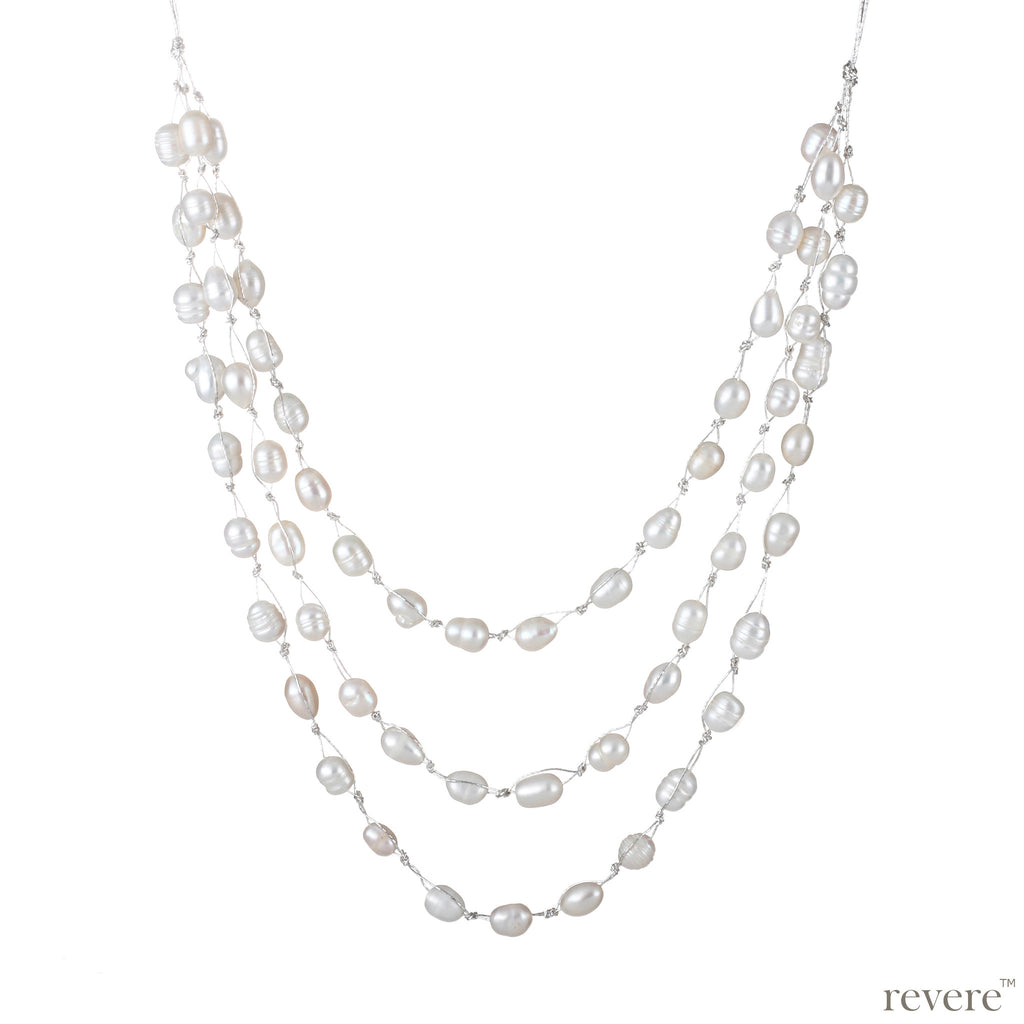 Cherish features three strings of delicate white freshwater pearls beautifully threaded on silver cord and fastened by an alloy clasp. A feel happy, anytime anywhere piece - a bit like Cinderella's glass slipper.