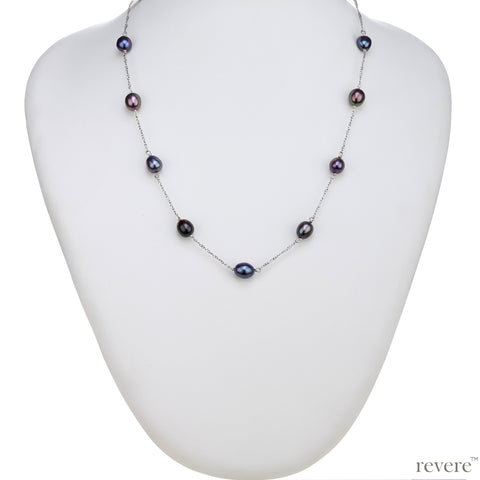 "Elegant and rare dark grey freshwater pearls with peacock hues scattered on a sterling silver chain. ""Eclectic"" will enhance any outfit, formal, casual, work and party!"