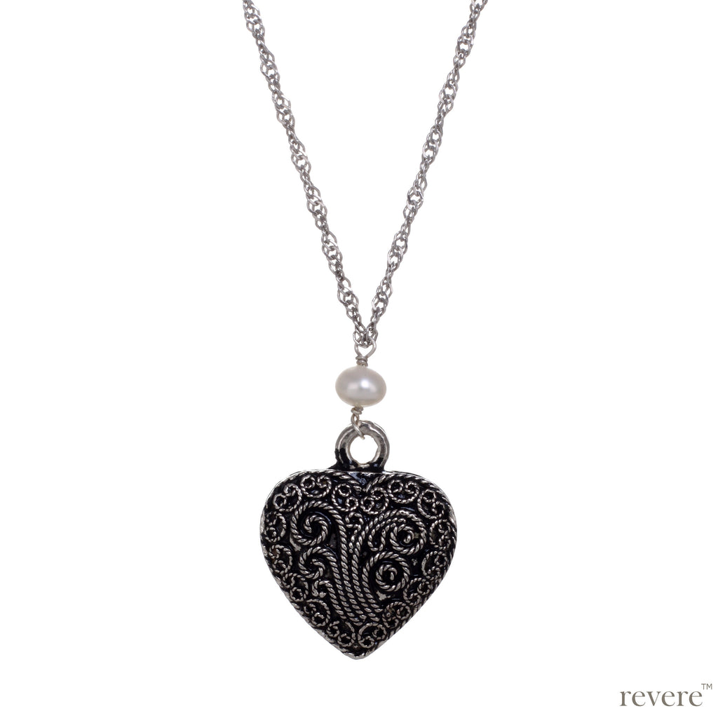 Intense Necklace..depicted by the timeless symbol of love.. a heart..draped on a long beautiful sterling silver chain studded with white pearls.. A timeless classic indeed.