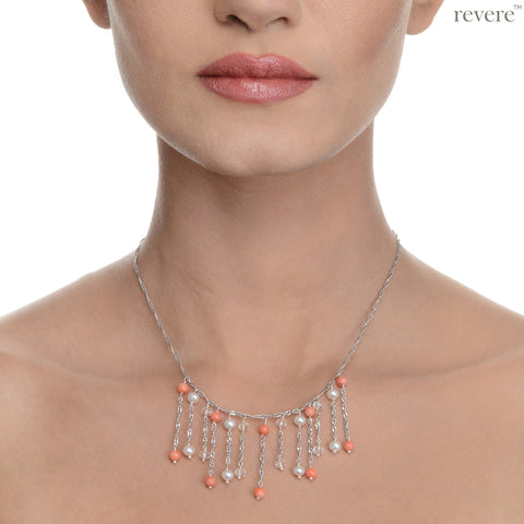 "Taiwanese Coral, pearl and crystal on a sterling silver chain with rhodium plating, with an extendable chain of 2""."
