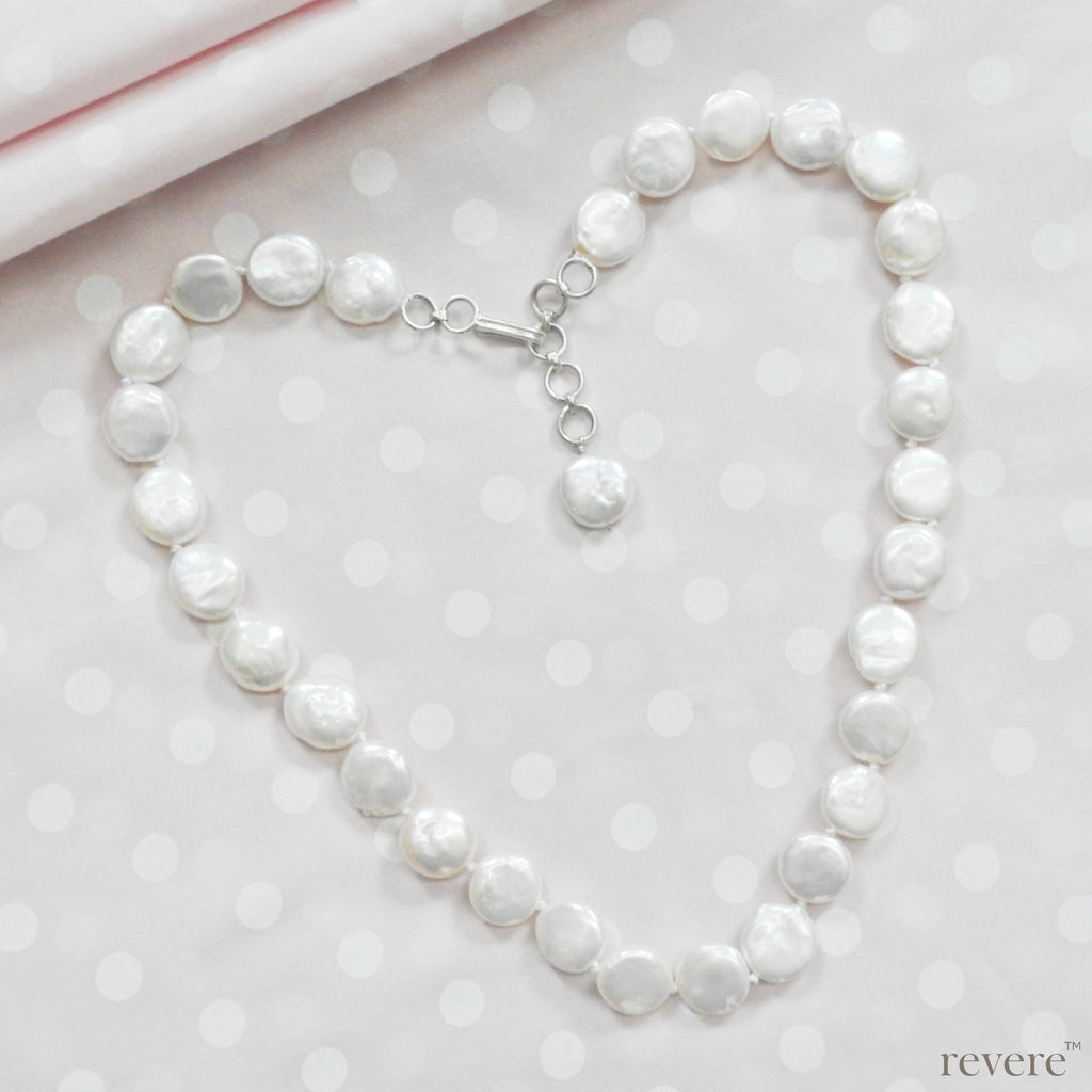 """City Lights"" features carefully selected handknotted freshwater white coin pearls. Bright, beautiful, exquisite…"