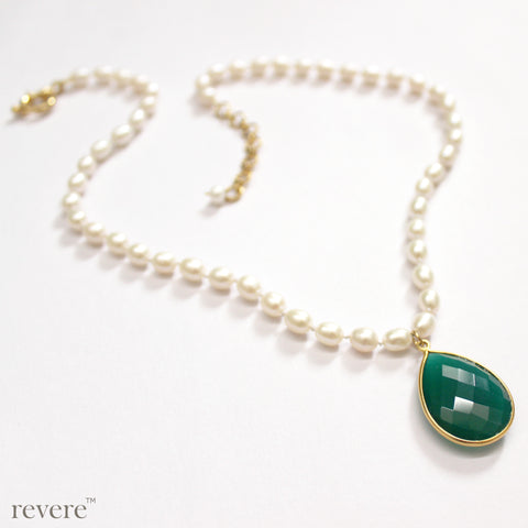 Lucent necklace is a beautiful green onyx pendant delicately suspended from a hand knotted strand of white freshwater pearls.