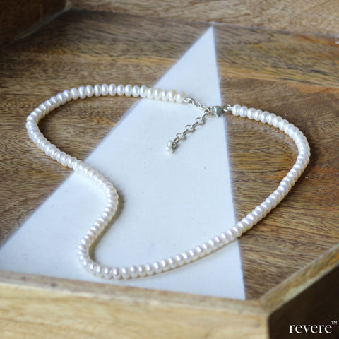 Every girl should have one.. the classic white pearl strand. This stunning piece features carefully selected freshwater pearls in, hand-knotted and fastened by a sterling silver adjustable.